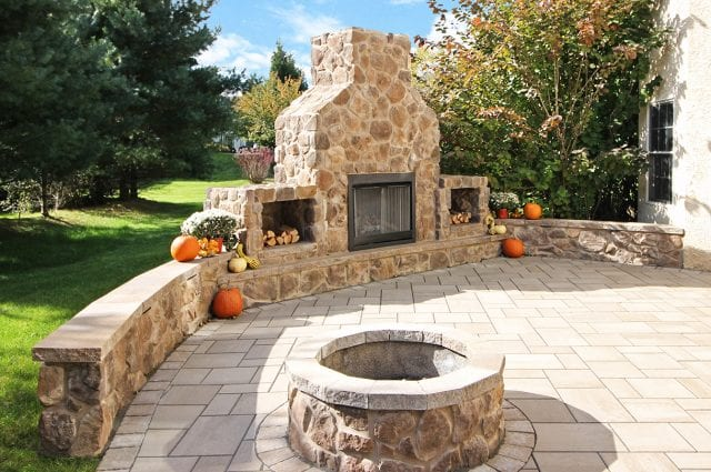 Casey - Flagstone patio with stonework fireplace and fire pit