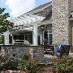 Morgan - Stonework outdoor kitchen and Arcadia pergola