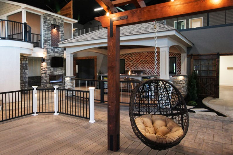 keystone custom decks inspiration center featuring pergola with hanging egg chair