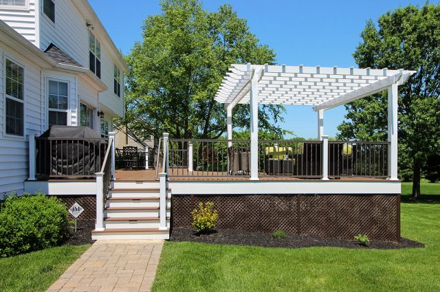Weiss - timbertech tropical antique palm deck with pergola