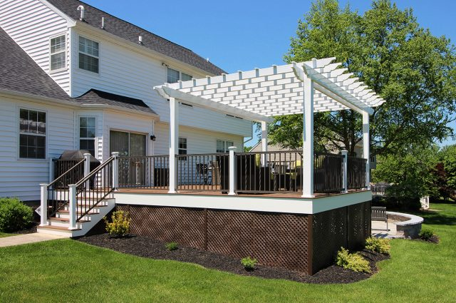 Weiss - timbertech tropical antique palm deck with pergola and lattice