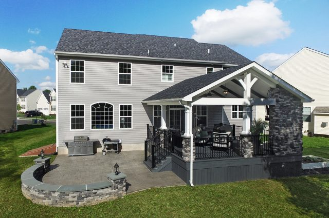 Custom Amazon Mist TimberTech Deck Porch Patio with covered fireplace and tv in Collegeville, PA