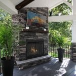 Custom Amazon Mist TimberTech Deck Porch Patio with stone fireplace and television Collegeville, PA
