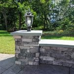 Custom Amazon Mist TimberTech Deck Porch Patio with stone wall and light post in Collegeville, PA