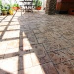 custom pergola patio porch with white columns and stonework in birdsboro pa
