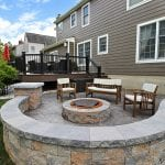 Stamped concrete patio with techo bloc sitting wall in west chester pa