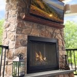 Berghuis - aspen fieldstone veneer tv and fireplace