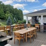 Kielinski - timbertech silver maple deck and porch with Pennsylvania ledgestone veneer columns