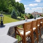 Kielinski - timbertech silver maple deck and porch with flagstone bar counter