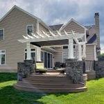 Koloseike - Timbertech pecan deck with provia terra cut slate stone veneer