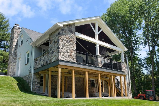 Legg - timbertech amazon mist deck and porch with PA top rock stone veneer
