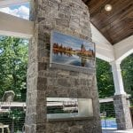 Malloy - rolling rock arcadian ashlar stone veneer fire place and tv