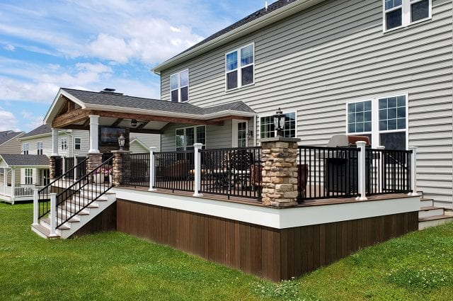 Osifat - timbertech mocha deck and porch with stone columns