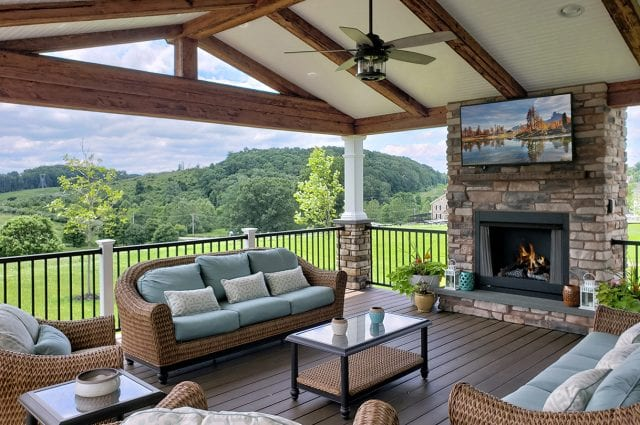 Osifat - timbertech mocha deck and porch with stone fireplace and tv