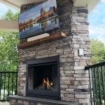 Zook - PA ledgestone veneer fireplace with barnwood mantel