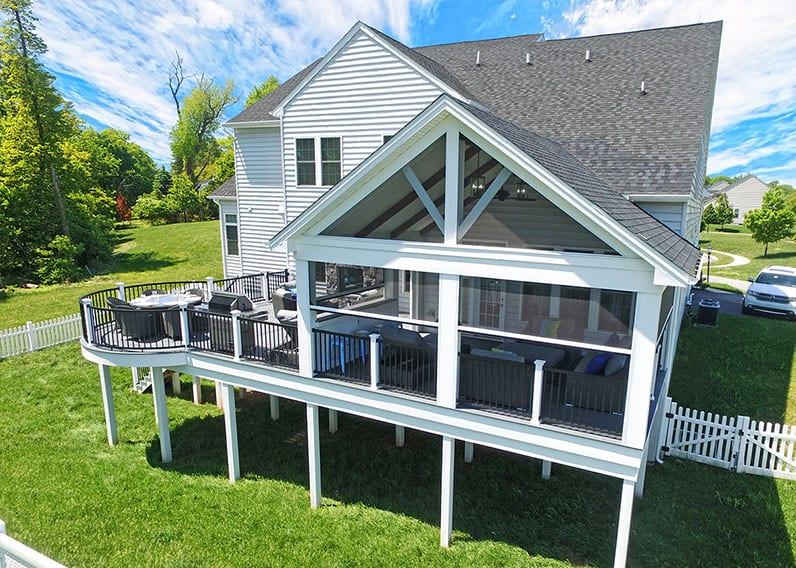 outdoor living space with deck and phantom screened porch