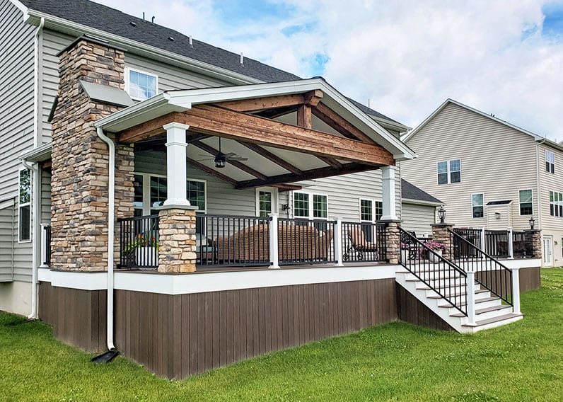 outdoor living design with deck and barnwood porch