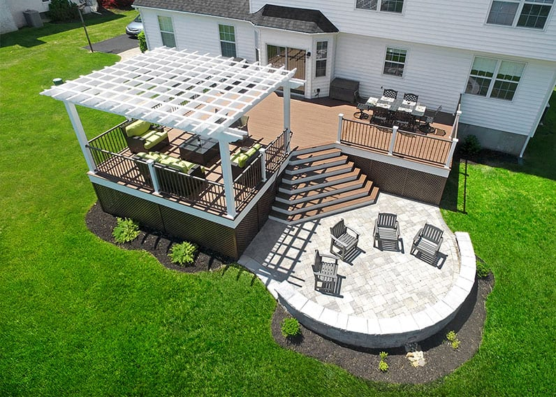 outdoor living design with pergola on deck and patio