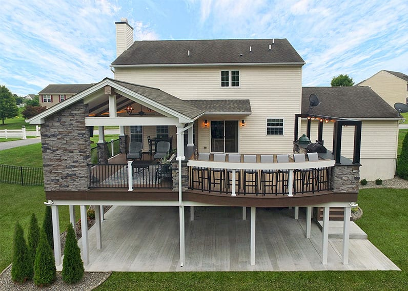 outdoor living space with elevated deck and barnwood porch